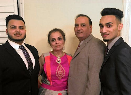 Our owner, Dhiren Pathak, poses with his wife and sons